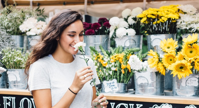 cute woman smelling flower desktop