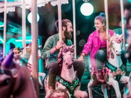 couple in love on carousel