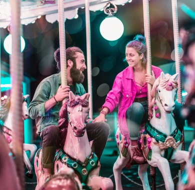 couple in love on carousel mobile