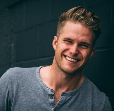 man smiling mobile