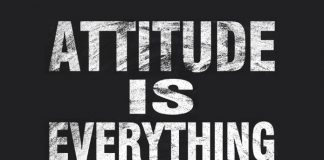 Attitude is everything text is written by white chalk on blackboard.